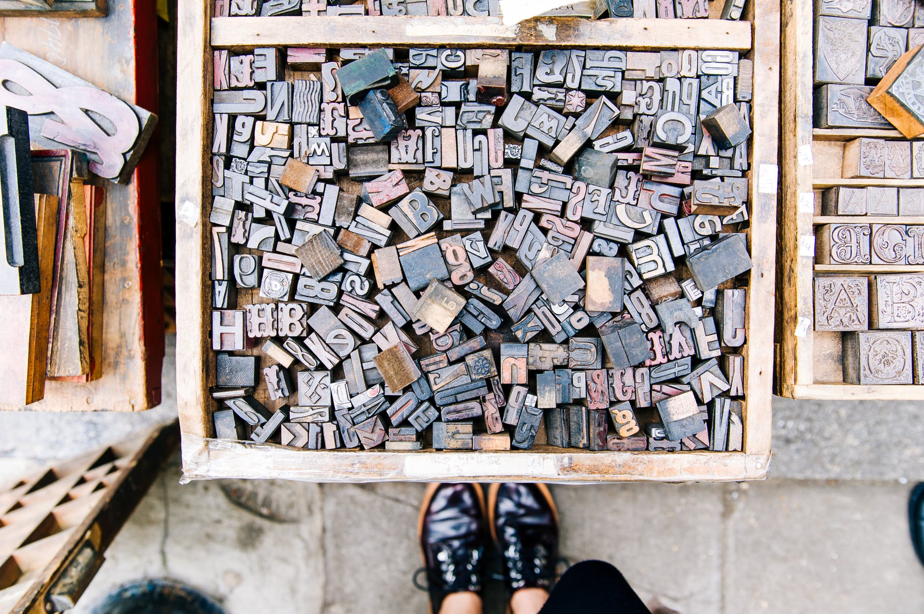 assorted wooden alphabets inside the crate